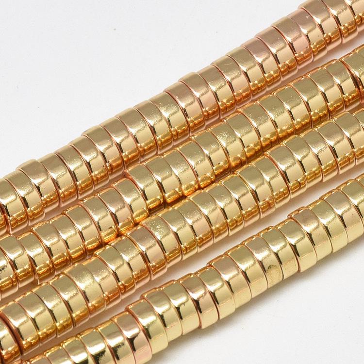 Ljust guldfärgad hematit rondeller 6x2 mm, 1 sträng