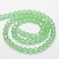 Facetterade glaspärlor 6 mm ljusgröna, 1 sträng