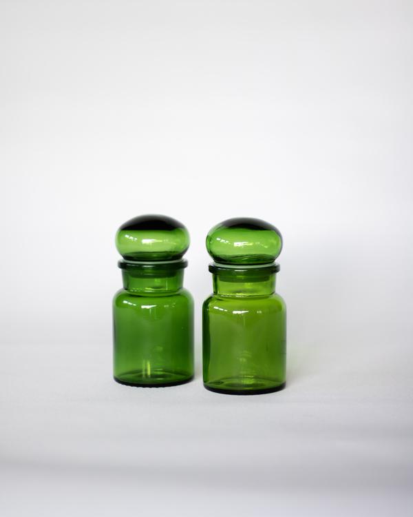 Grønt apotekerglass med lokk