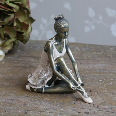 Ballerina sittandes