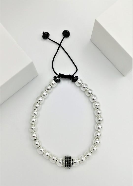 Wheal Charm Pearl Pärlarmband bild 2 är ett vacker och flexibel herr armband med ett vackert kombination.