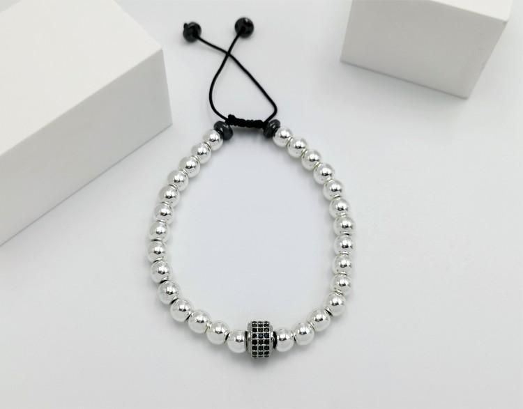 Wheal Charm Pearl Pärlarmband bild 1 är ett vacker och flexibel herr armband med ett vackert kombination.