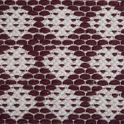 Temmy 160 x 230 cm en snygg bomullmatta med ett skönt mönster. Färg: Vinröd och off-white.