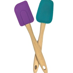 Slickepott i silikon med trähandtag. Skålad. Färg: Grön.