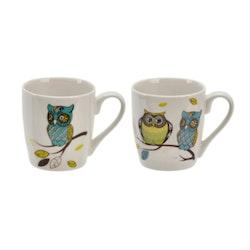 Owl 2 en kaffe/temugg i New bone China. Färg: Vit med ett uggletryck.