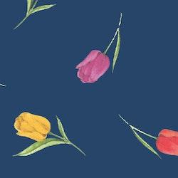 Vaxduk på metervara från Nobel house. Färg: Blå med färgglada tulpaner. Bredd 140 cm.