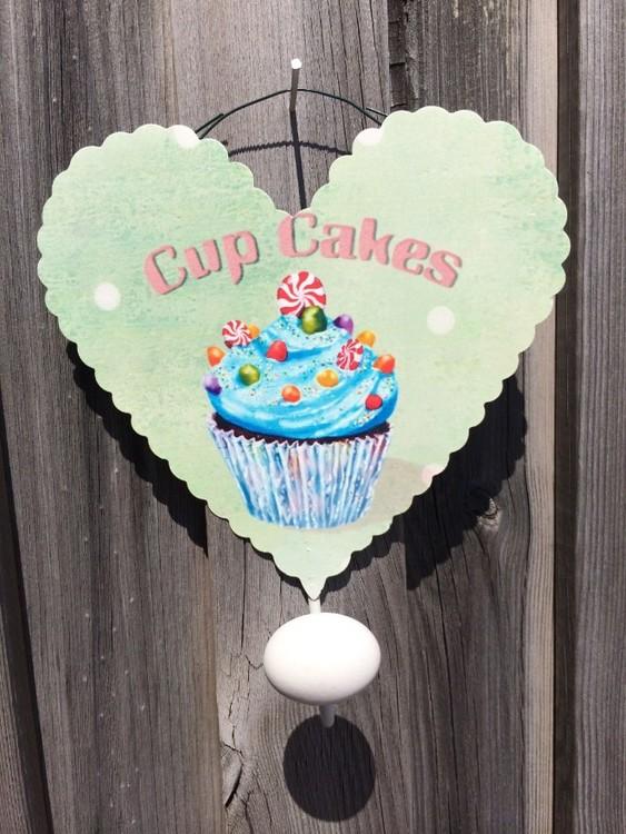 Väggkrok Cup cake i grönt. Mått: H 20 cm. B 16 cm.