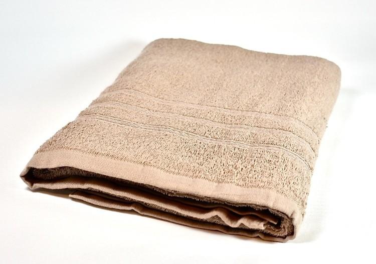 Frottébadlakan Soft från Noble house. Färg: Beige. Mått: 70 x 130 cm.