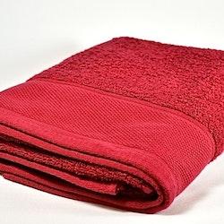 Frottébadlakan Siljan i ekologisk bomull från Gripsholm. Färg: Röd. Mått: 70 x 130 cm.