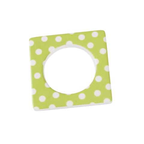 Change ljusmanchett från Cult design. Färg: Grön med vita prickar.