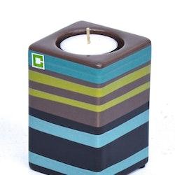Kub Stripy cold värmeljushållare från Cult design. Färg: Svart, mullvad, grön och blå.