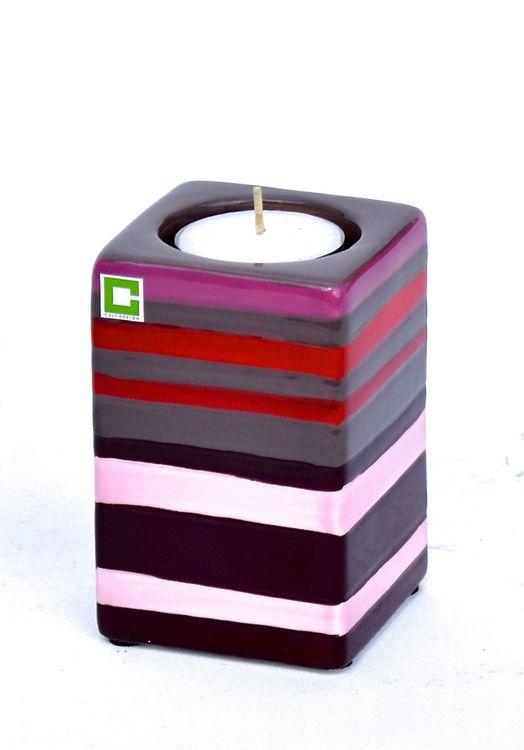 Kub Stripy warm värmeljushållare från Cult design. Färg: Mullvad, rosa, och röd.