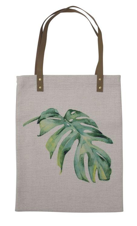 Leafe en liten shoppingväska med handtag i konstläder. Färg: Beige med ett grönt digitaltryck.
