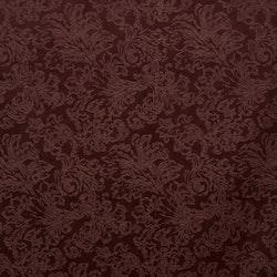 Adrienne ett kuddfodral i präglad sammet. Färg: Vinröd. Mått: 45 x 45 cm.