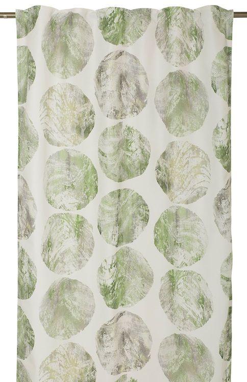 Bilog ett gardinset med multiband. Färg: Vit med melerade prickar i grönt och grått. Mått: 2 x 130 x 263 cm.