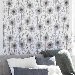 Amaryllis ett gardinset med öljetter. Färg: Vit med ett grått amaryllistryck.