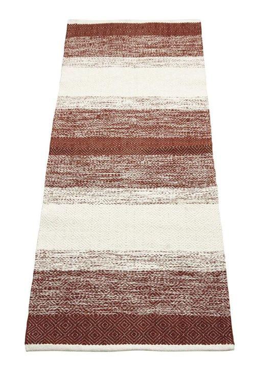 Sandra 140 x 200 cm en snygg bomullmatta med ett skönt mönster. Färg: Rödbrun och off-white.