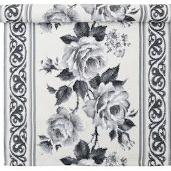 Rose är en vackert vävd löpare. Färg: Off-white och svart. Mått: 35 x 70 cm.