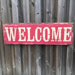 Welcome en härligt ¨sliten¨ tavla. Färg: Rosa, petrol och träfärgad. Mått: B 81, H 25,5 D 4,5 cm.