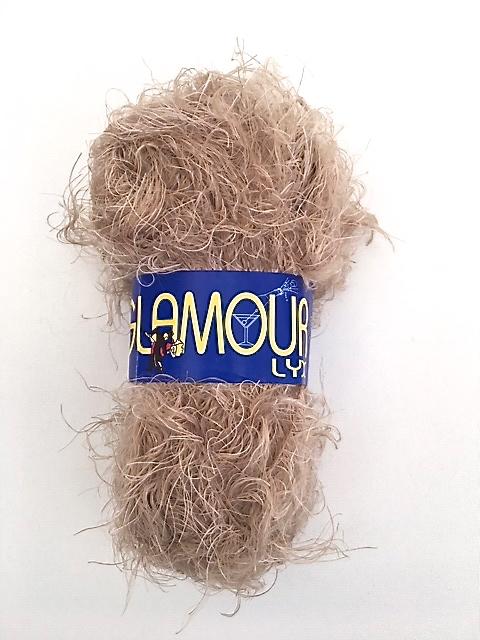 Glamour lyx från Falk garn 50 gr. Färg: Beige melerad.