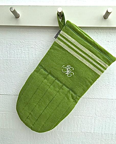 Bistro en grytvante i 100% bomull med stor ¨tumme¨. Färg: Grön och vit.