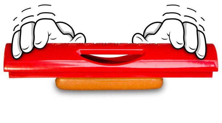 Korvverktyget Slotdog som kommer att förvandla den tråkiga varmkorven till en gourmémåltid. Färg: Röd.