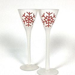 Snöflinga ett 2 pack med snapsglas. Färg: Frostat glas med en röd snöflinga.