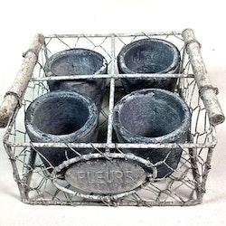 Fleurs ett set med 4 småkrukor i en metallkorg. Färg: Grå krukor i en grå metallkorg.