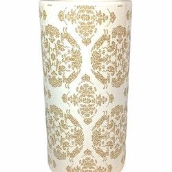 Cylinderkruka i ett medaljongmönster. Färg: Vit och guld.