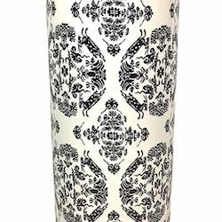 Cylinderkruka i ett medaljongmönster. Färg: Vit och svart.