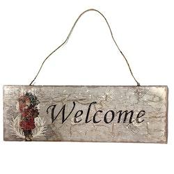 Skylt Welcome i trä med en patinerad look.