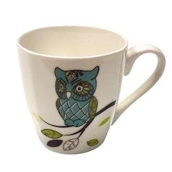 Owl 1 en kaffe/temugg i New bone China. Färg: Vit med ett uggletryck.