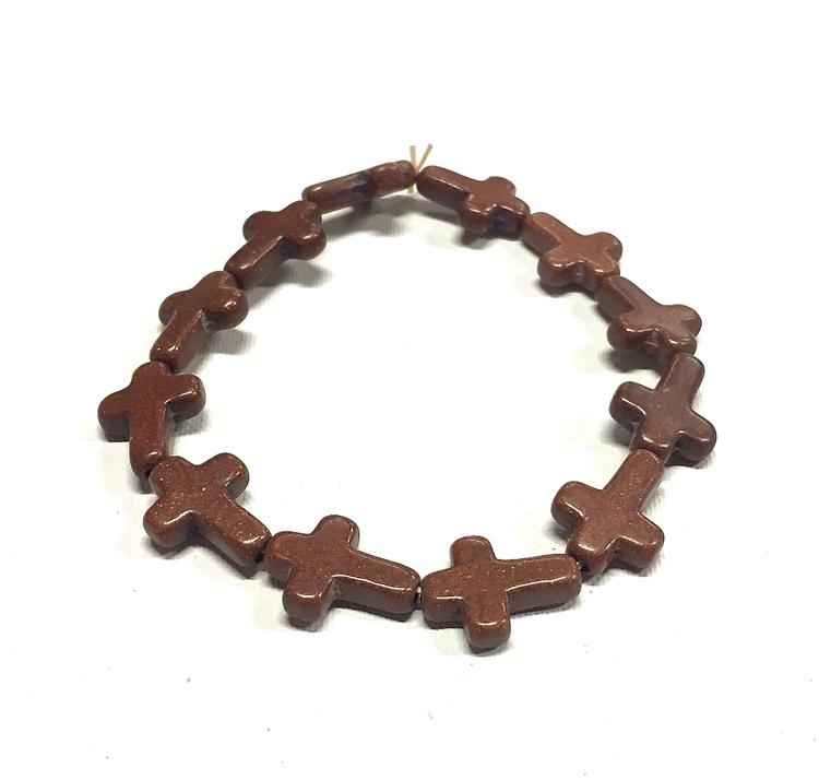 Armband med kors i polystone med elastiskt band. Art.nr: H 02002. Färg: Brunt.