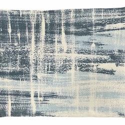 Meadow mist en tablett i en grovt vävd bomull. Färg: Vit med blå toner.
