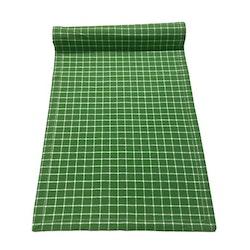 Löpare i bomull. Färg: Grön med vita rutor.