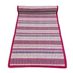 Sprall en löpare i bomull. Färg: Multifärgad med Rosa kantband.