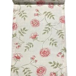 Rosenslinga en löpare i bomull med rostryck från Gripsholm. Färg: Vit med rosa rosor och gröna blad.
