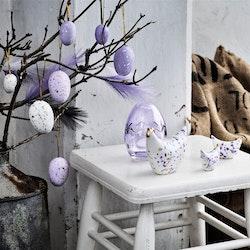 Stänk ägg i ett sexpack från Cult design att dekorera påskriset med. Färg: Lila och vita stänkmålade ägg.