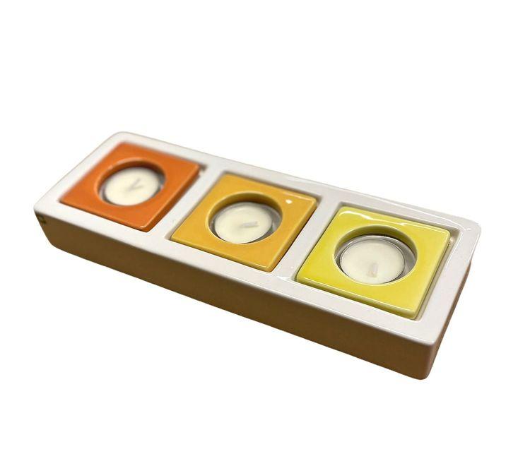 Change ljusmanchetter i trepack från Cult design. Färg: Gula och orange toner.