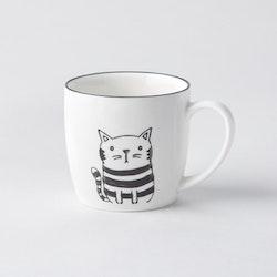 Katt en kaffe, te, chokladmugg i porslin. Färg: Vit med ett kattryck i svart.