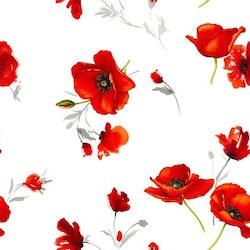 Vallmo en vaxduk på metervara. Färg: Vit med röda blommor.