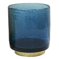Bubbles en ljuslykta i glas med en fot i mässing. Färg: Blå med en fot i mässing.