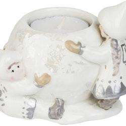 Snövättebarnens ljuslykta från Cult design. Färg: Vit med grå och beige inslag.