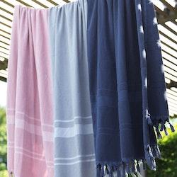 Hamam handuk i 100% bomull från Gripsholm. Färg: Ljus petrol.
