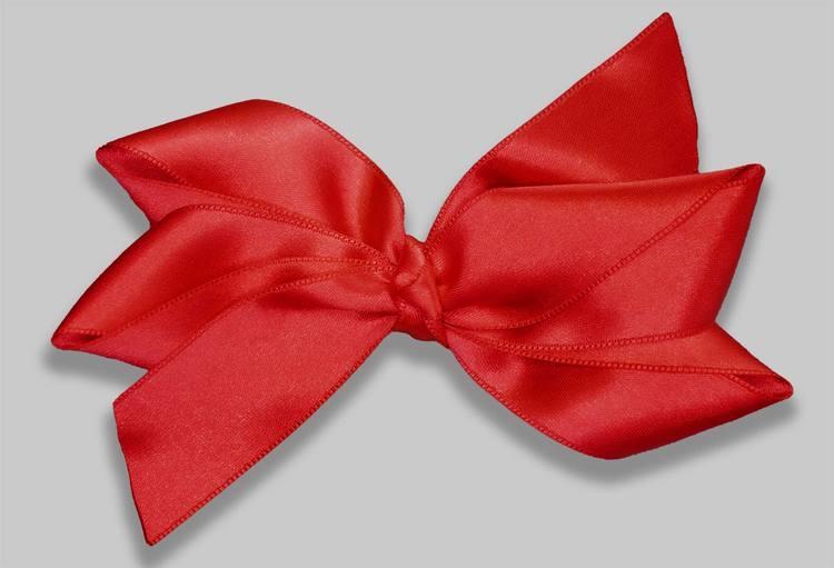 Julrosett. Hårrosett till jul. Rosetter till jul. Juligrosett. Röd rosett.