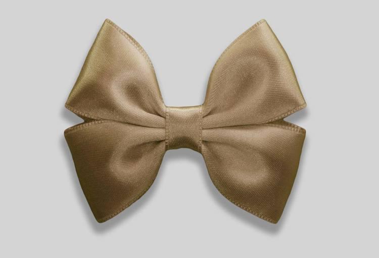 guldig hårrosett perfekt för baby och barn till julafton och nyårsafton. Nyårsrosett.