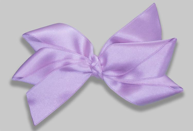 pastellfärgad hårrosett i ljuslila vårig och somrig nyans populär accessoar för håret