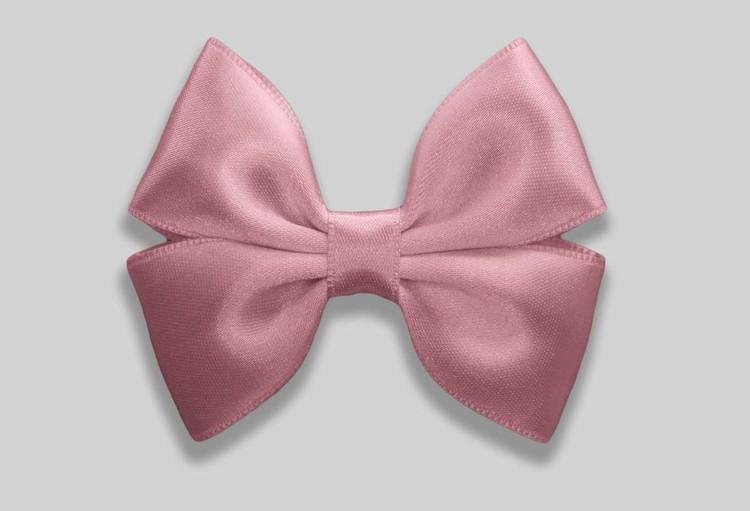 Mindre rosa rosett till håret