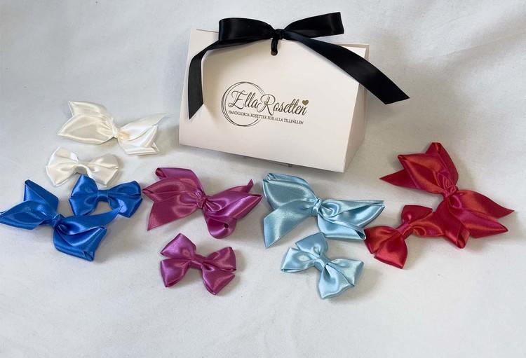 Presenter, giftbox, ellarosettens egna presentförpackning med hårrosetter, rosetterna kommer från ellarosetten.