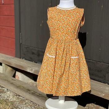 Flickklänning gula små blommor